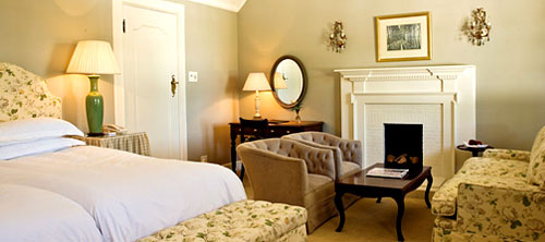 The Andros Boutique Hotel - Cape Reservations - Room with Fire Place